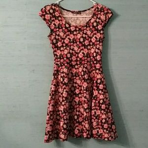 Peach floral dress with black background